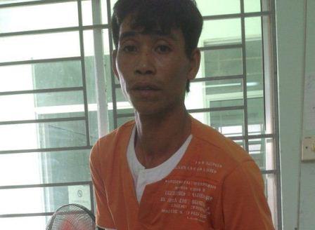 Đối tượng Phạm Minh Trung tại cơ quan điều tra. Ảnh: Dân Trí