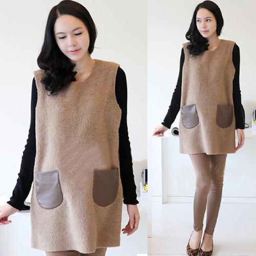 Quần legging kết hợp với áo len dáng dài hoặc váy suông là một lựa chọn thông minh