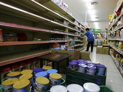 Bê bối sữa liên quan đến aflatoxin khiến doanh nghiệp phải thu hồi sản phẩm năm 2011