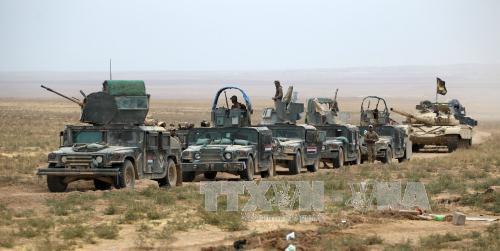 Chiến sự Syria hôm nay đề cập đến vấn đề Iraq cắt các tuyến tiếp viện IS từ Mosul tới Syria. Ảnh: AFP/TTXVN
