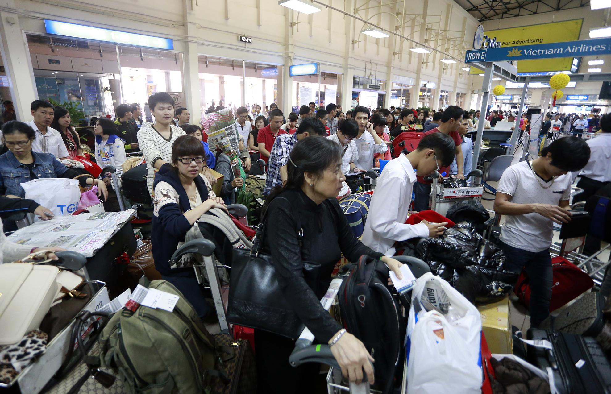 Mỗi dịp nghỉ Tết Nguyên Đán, lượng hành khách về quê ăn Tết bằng đường hàng không lại tăng đột biến. Ảnh minh họa