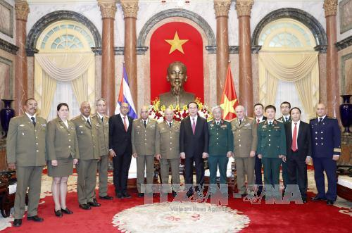 Chủ tịch nước Trần Đại Quang và đoàn đại biểu cấp cao Bộ các Lực lượng vũ trang cách mạng Cuba do đồng chí Thượng tướng Leopoldo Cintra Frías, Ủy viên Bộ Chính trị, Bộ trưởng dẫn đầu sang thăm hữu nghị chính thức Việt Nam. Ảnh: TTXVN