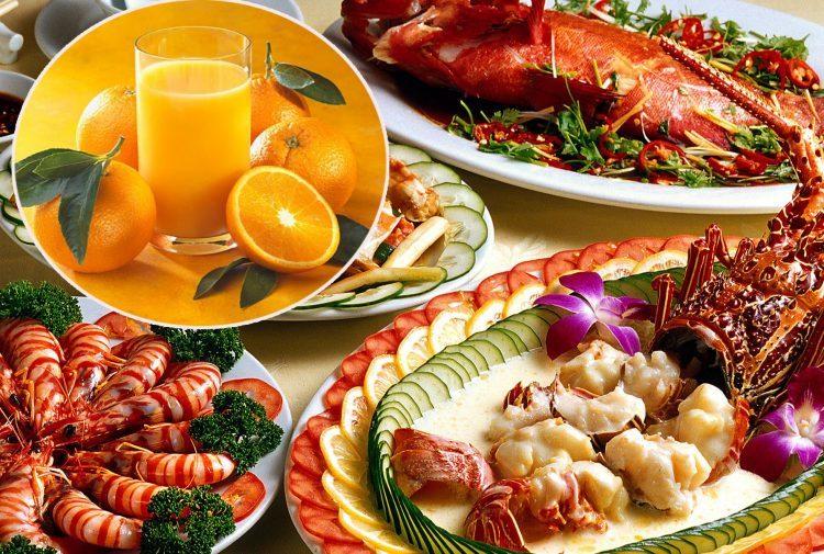 Nước cam rất kỵ với các món hải sản. Ảnh minh họa.