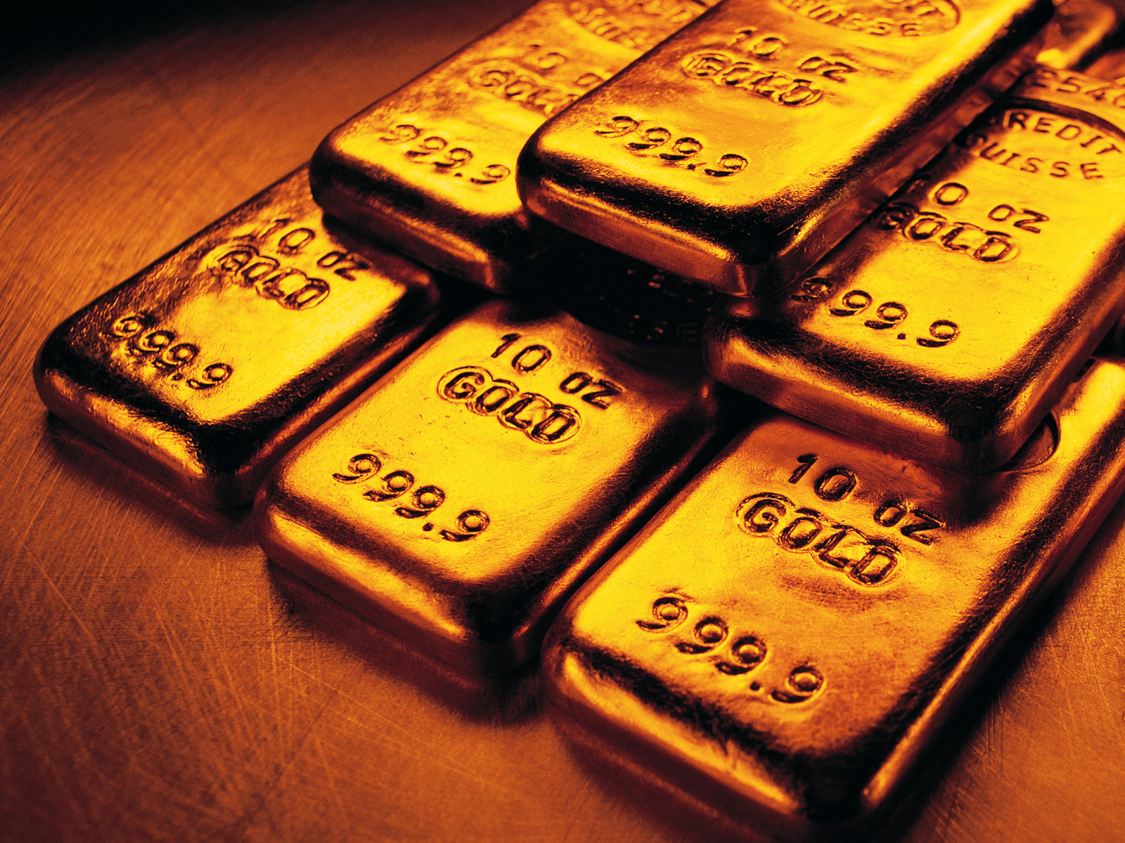 Giới chuyên gia dự đoán giá vàng thế giới khó trụ ở mốc 1.330 USD/ounce