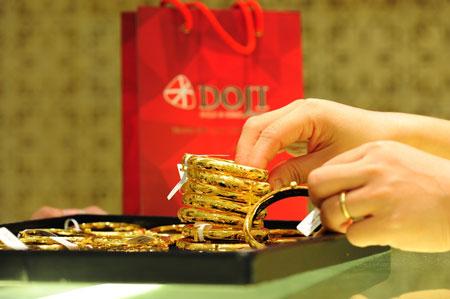 Hiện mức chênh lệch giữa giá vàng trong nước và giá vàng thế giới đã co hẹp lại, còn 3,7 triệu đồng/lượng