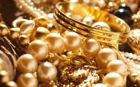 giá vàng hôm nay trên thị trường thế giới giao dịch ở ngưỡng 1.243,60 USD/ounce