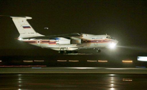 Máy bay Nga chở các thi thể nạn nhân hạ cánh xuống sân bay Pulkovo ở ngoại o St.Petersburg (Ảnh: AP)