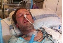 Dustin Theoharis nằm hôn mê tại bệnh viện sau khi bị cảnh sát bắn nhầm, theoo tin tức mới nhất. Ảnh Mirror