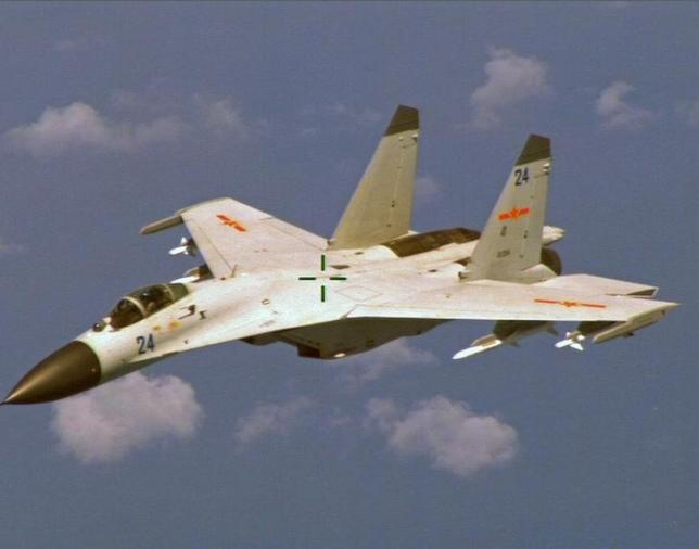 Chiến đấu cơ J-11 của Trung Quốc từng áp sát máy bay P-8 Poisedon của Mỹ ở Biển Đông tháng 8/2014