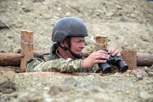 Binh sĩ Ukraine gác tại chốt quân sự ở Popasna, vùng Donetsk