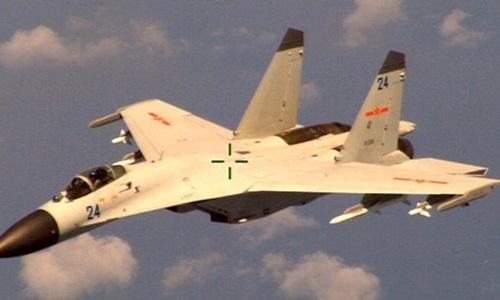 Máy bay Mỹ - TQ chạm trán