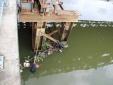 Phát hiện thi thể nữ mặc đồ tím, đeo trang sức trôi lập lờ trên kênh Nhiêu Lộc
