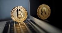 http://vietq.vn/dau-tu-tien-ao-bitcoin-can-than-keo-ca-nha-ra-duong-d133362.html