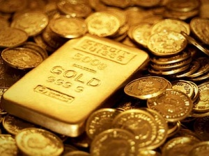Giá vàng hôm nay ngày 25/2/2015: Giá vàng giảm tuần thứ 7 liên tiếp, đồng đô la mạnh lên