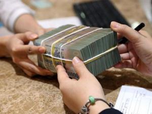 Các ngân hàng không hạ chuẩn cho doanh nghiệp vay: NHNN nói gì?