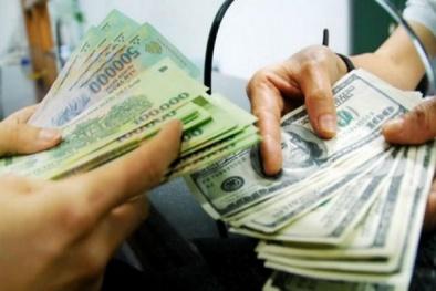 Bắt 2 người liên quan đến vụ đổi 100.000 USD giả tại ngân hàng